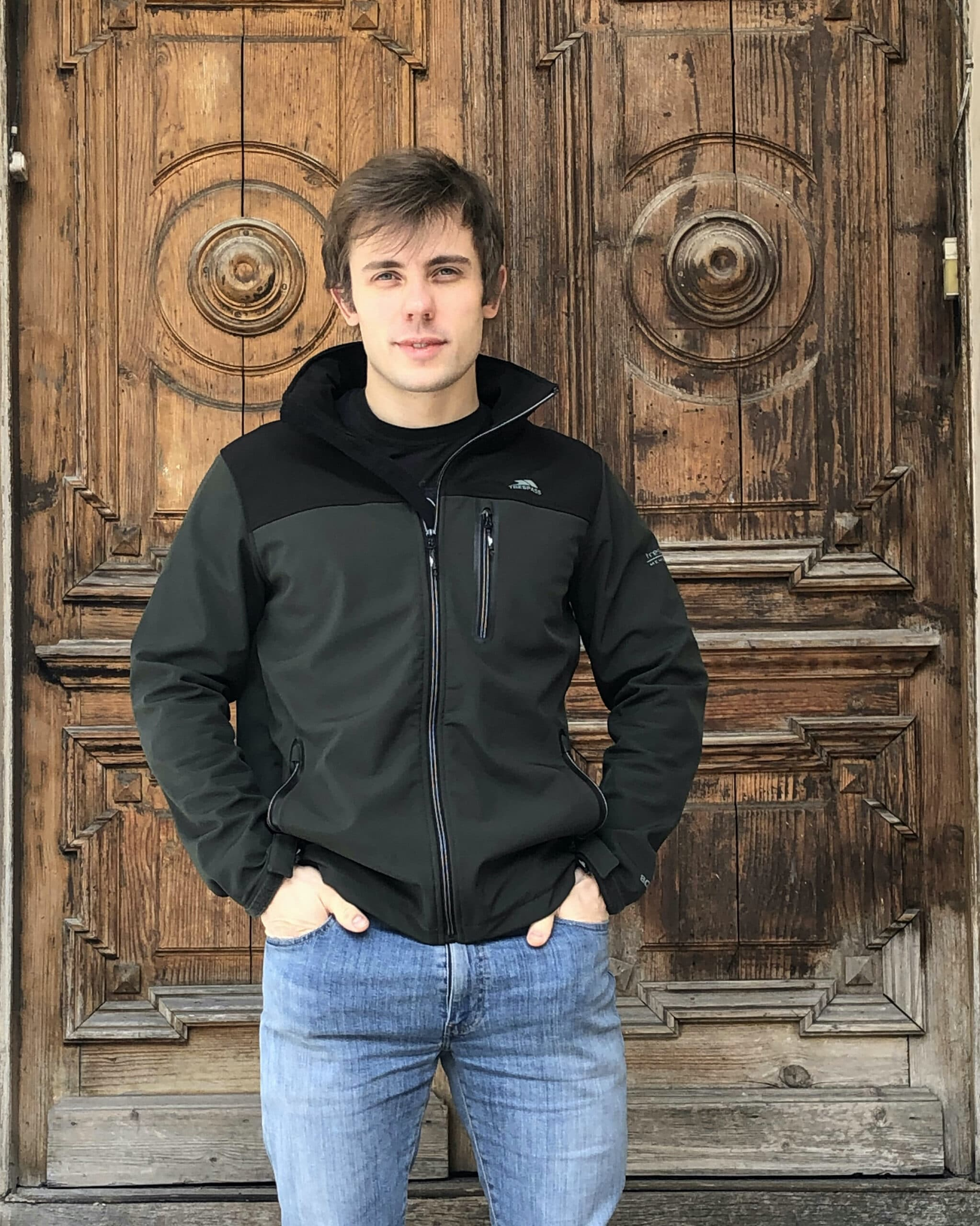 Picture of Co-Founder, Mircea Cornelison, in green jacket and blue jeans